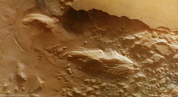 "Mars' ""Juventae Chasma (11337951926)"" by European Space Agency - Juventae Chasma. Licensed under CC BY-SA 3.0-igo via Wikimedia Commons – link here"